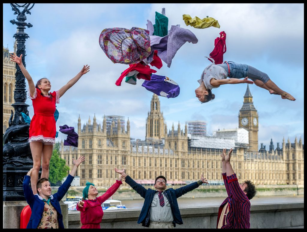Image ©Licensed to i-Images Picture Agency. 25/07/2017. London, United Kingdom. Circus250 - Celebrating 250 years of Circus. Acrobats from the group Lost in Translation perform a stunt in front of the Houses of Parliament in London for Circus250. The display is to draw attention to the 250th year since a circus was held for the first time, at a spot near this location. Picture by Pete Maclaine / i-Images