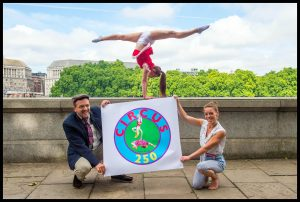 Image ©Licensed to i-Images Picture Agency. 25/07/2017. London, United Kingdom. Circus250 - Celebrating 250 years of Circus.<br /> Acrobats from the group Lost in Translation perform a stunt in front of the Houses of Parliament in London for Circus250. The display is draw attention to the 250th year since a circus was held for the first time near this location.<br /> Picture by Pete Maclaine / i-Images